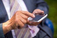 Senior man with his cellphone Stock Photos