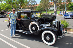 Senior man by his classic 1933 Lincoln Coupe. Royalty Free Stock Photography