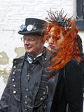 Senior man with his daughter in Gothic attire. Royalty Free Stock Photography