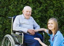 Senior Man with his Doctor. Kind doctor helping patient with Alzheimer's disease Stock Photography