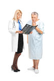 Senior man with his doctor looking at his CT Stock Photography