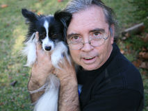 Senior Man and Papillion Dog royalty free stock photos