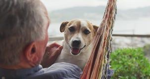 Senior man and his dog at home