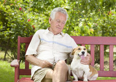 Senior man with his dog Stock Photo