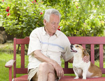 Senior man with his dog Royalty Free Stock Images