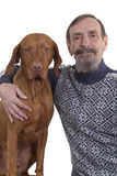 Senior man and his dog posing together Royalty Free Stock Photos