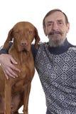 Senior man and his dog posing together Royalty Free Stock Photos