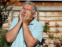 Pain or ache in the eyes. Problems with vision. Senior man with his hands to his eyes. Pain or ache in his eyes. Bad vision. Blurred. Trouble seeing stock photo
