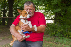 Senior man with his lovely basenji dog Royalty Free Stock Image