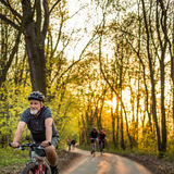 Senior man on his mountain bike outdoors. (shallow DOF; color toned image stock photography