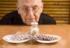 Senior man and his pills Stock Photo