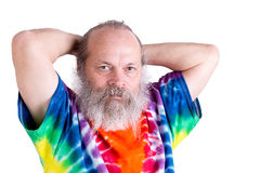 Senior Man With his Tie Dye T-Shirt Holding his Hair on the back Stock Photo