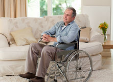 Senior man in his wheelchair Stock Photos