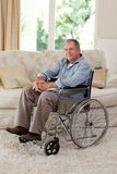 Senior man in his wheelchair Stock Photography