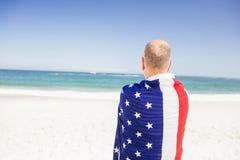 Senior man holding american flag Stock Photos