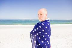 Senior man holding american flag Stock Image