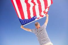 Senior man holding american flag Stock Images