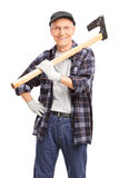 Senior man holding an axe over his shoulder Royalty Free Stock Photos