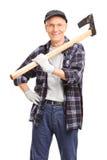 Senior man holding an axe over his shoulder Royalty Free Stock Photos