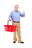 Senior man holding basket and giving thumb up Stock Photography