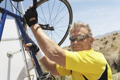 Senior Man Holding Bicycle Stock Photography