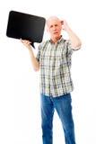Senior man holding a blank speech bubble and thinking Stock Photo