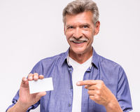 Senior man. Is holding blank visiting card royalty free stock photos