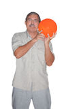 Senior man holding bowling ball isolated Stock Images
