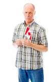 Senior man holding a Canadian flag Stock Images