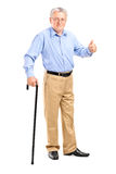 Senior man holding a cane Stock Images