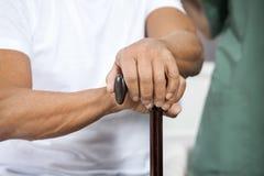 Senior Man Holding Cane In Rehab Center Stock Image