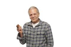 Senior man holding cigar Royalty Free Stock Images
