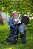 Senior man holding credit card outdoors Stock Photo