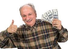 Senior man holding dollar bills Royalty Free Stock Photography