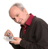 Senior man holding at dollar bills Stock Photography