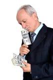 Senior man holding dollar bills Stock Photo
