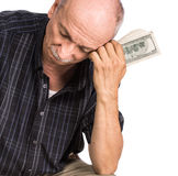 Senior man holding dollar bills Royalty Free Stock Image