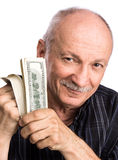 Senior man holding dollar bills Royalty Free Stock Images
