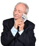 Senior man holding dollars Royalty Free Stock Images