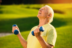 Senior man holding dumbbells. Stock Photography