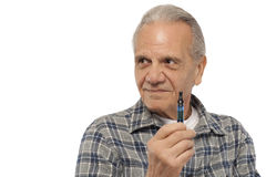 Senior man holding Electronic Vapor Cigarette Royalty Free Stock Image