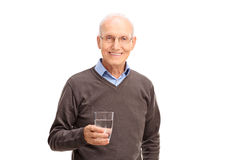 Senior man holding a glass of water Stock Images