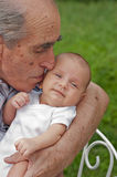 Senior Man Holding His Great-grandson Royalty Free Stock Photo