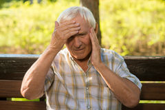 Senior man holding his head. Stock Image