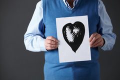 Senior man holding ink drawing  Royalty Free Stock Photos