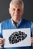 Senior man holding ink drawing of brain Stock Photography