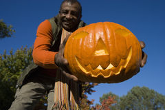Senior man holding jack-o-lantern Stock Photography