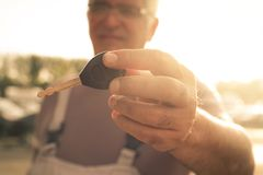 Senior man holding key car. Royalty Free Stock Photo