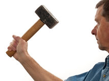 Senior man holding a large hammer Royalty Free Stock Photos
