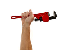 Senior man holding a large wrench Royalty Free Stock Photo